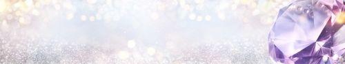 Скинали - Бриллиант крупным планом на размытом блестящем фоне