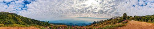 Скинали - Облака над горной местностью с цветами